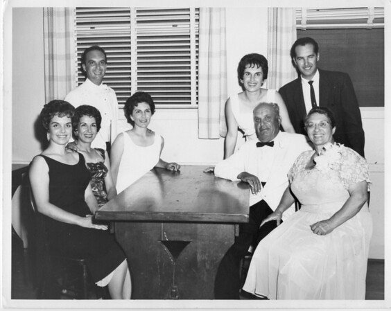 Pasquale (Pat) Buono wedding to Jeannie (Klucker) Buono Reception. Left to Right: Rosie (Buono) Ybarra, Conjet (Buono) Marino,Teresa (Buono) De Santi, Lena (Buono) Valenti, Frankie Buono Jr., Frank and Julia Buono. (Aunt Rosie never heard the end of this photo for allowing her slip to show)