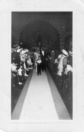 Carl and Conjet Marino wedding leaving the church with ring boy Frankie Buono Jr.
