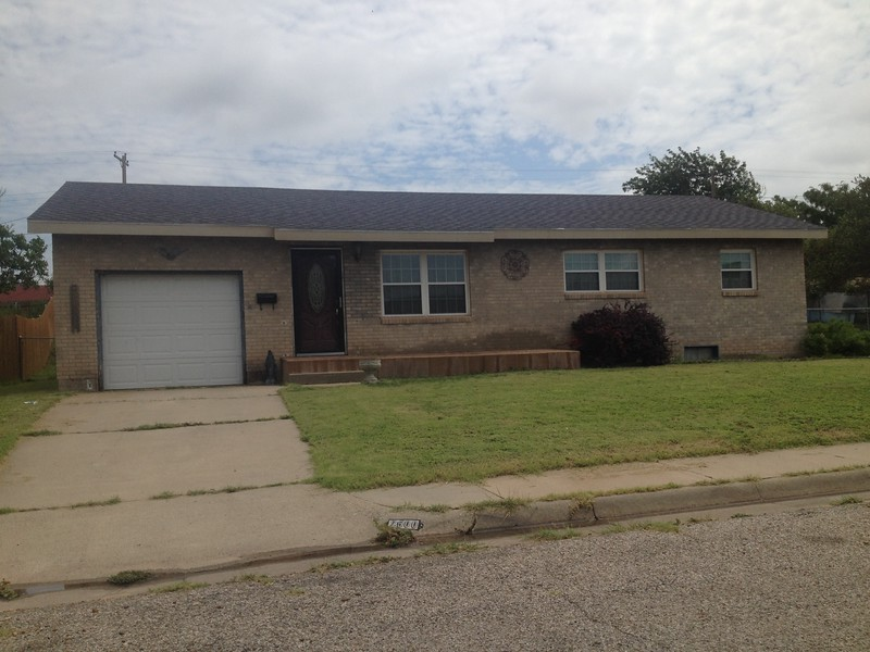 I believe this is the last house in Amarillo we lived in before moving to Borger. Dad had a 1956 2dr sedan, black and white, Chevrolet. He purchased a 1959 blue Volkswagon to drive to Borger as Miliam had Dad open a store in downtown Borger. You can see one basement window on the right.<br /> <br /> I had a full size pool table in the basement and Mom did not want Uncle Buddy to know their was a pool table in the house. So one Thanksgiving she wanted to use it as the dining table. That did not happen, and when Buddy, Lucille and Dwayne came over for Thanksgiving Uncle Buddy watched Dwayne and I play pool :-)