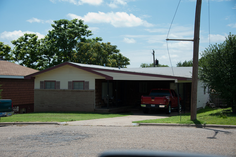 This is a house where Mom, Dad, Sandra and I lived in around 1961-1964. The Forsites lived next door to the left of the photo.  The house had a basement, split level back yard and the carport was added after we moved from here.