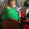 A Toddler in a Cradle