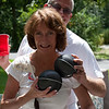 Patti and John play with her balls (actually portable speakers)