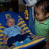 14Sep09 - Cousin Hailey trying to figure out Freddy