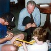 Paul Buchanan, Fred and Jason Thorpe Buchanan at Easter putting together a mechanical toy.  Fred enjoying it as much as Jason!