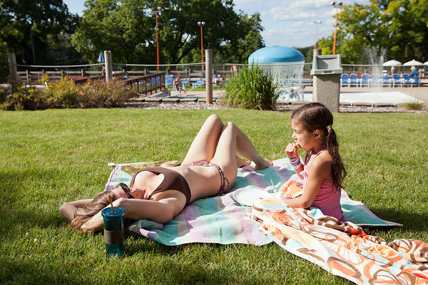 Teri & Freja Lutz sun & snack while at Mt Horeb pool.