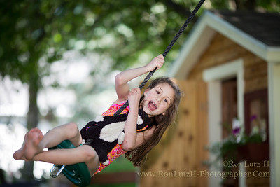 The kid's a regular daredevil! She keeps talking my wife into swinging her higher, and higher on her disk swing.