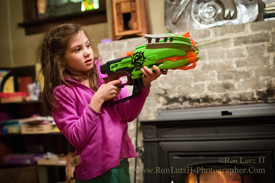 Today I took Freja shopping for toys as she still had a lot of money left over from both Christmas and her birthday that Papa had gifted her. She wanted some Nerf guns she'd seen on TV, and I have to admit I thought they were kind of fun looking.   We set up some targets on the inside of the pocket door into the den. The rest of the night was literally a BLAST!