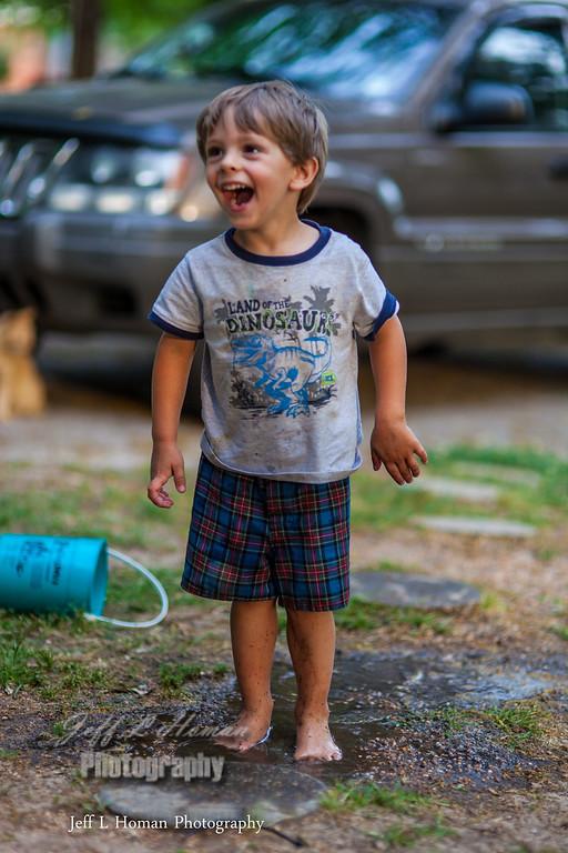IMAGE: http://jefflhomanphotography.smugmug.com/Family/Friends-Family/i-CRQH9QX/1/XL/he-loves-the-mud-XL.jpg