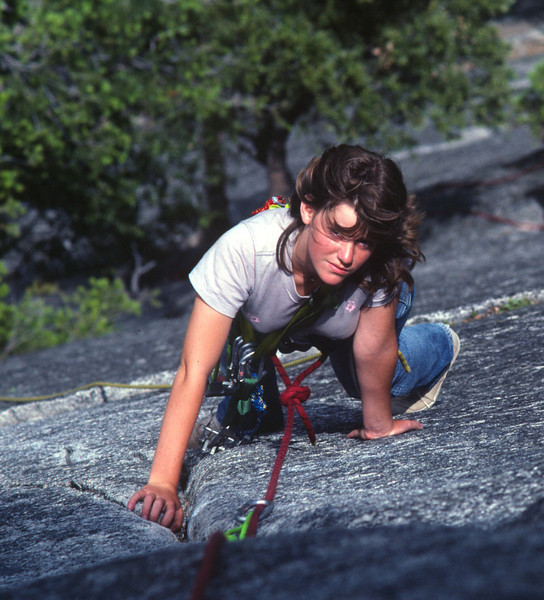 Andi climbing the Harry Daley Route on Monday Morning Slab in Yosemite.