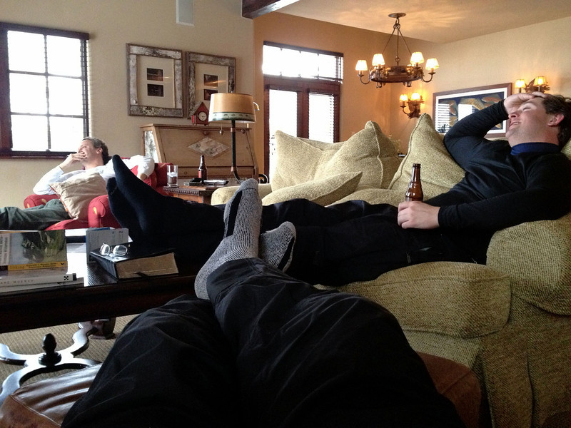 The boys are kicked back after a long day on the slope!
