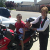 Kamari and Deshawn trying out Uncle John's motorcycle.