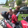 Grandma helping Deshawn try out the Weestrom.