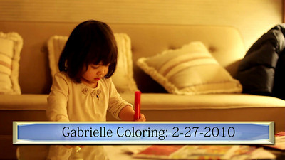 A beautiful scene of the baby coloring and using some words.