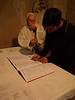Cristian firmando como padrino