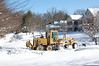 The plow is having trouble, so here comes another plow to help out (see it, up the street?).