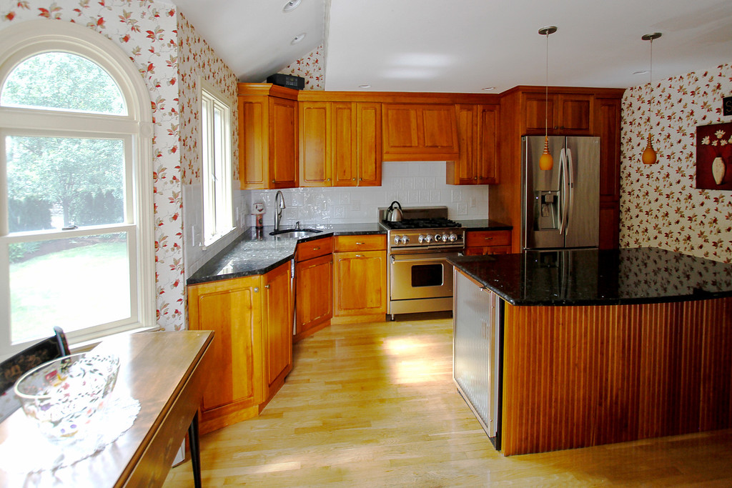Sunny kitchen with high end appliances, granite counter tops