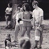 Janis on ground, Mom in striped outfit and big hair, Dad in sunglasses and sideburns, Jamie looking at camera