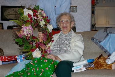 December 25, 2009 [Christmas] - (David's house / Manchester, Saint Louis County, Missouri) -- Vera opening Christmas present; door wreath from her grandchildren