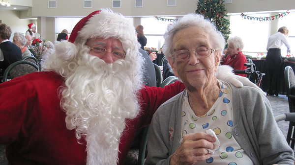 December 17, 2010 - (Autumn View Gardens / Ellisville, Saint Louis County, Missouri) -- Santa & Vera at Christmas party [Vera's face bruised from recent fall]