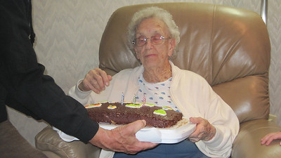 April 16, 2011 [Birthday] - (David & Mary Anne's house / Manchester, Saint Louis County, Missouri) -- Vera with her birthday cake after blowing out the candles