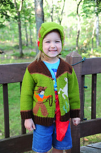 Meadow Sepke with sweater and hat made by her great-grandmother, Lucile Rule