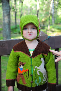Willow Rule wearing a sweater and hat made by her great-grandmother, Lucile Rule