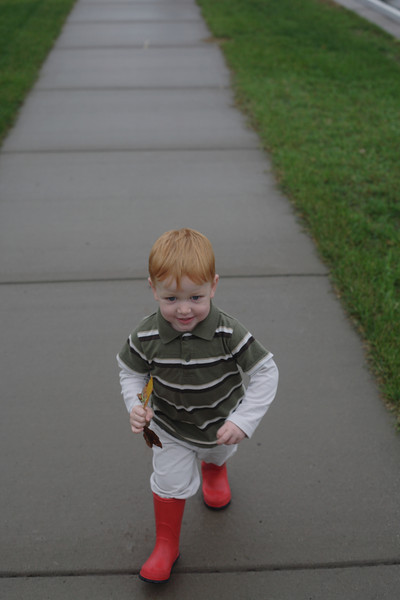 Matthew <br /> Katie and Matthew went for a walk in the puddles after the rain.