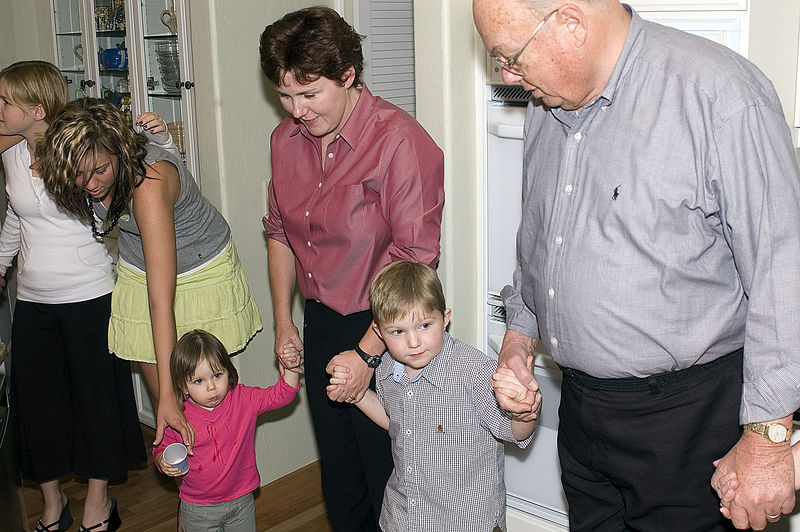 (11-24-2005)  Connor getting ready to say grace before Thanksgiving dinner.