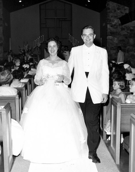 wedding mom and dad walking down the aisle
