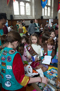 Troop 7669 telling some brownies about Pakistan, stamping their passports and giving bangles.