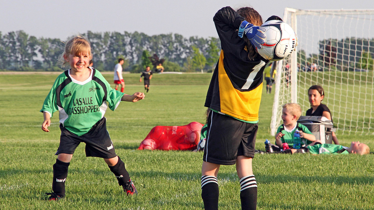 Slideshow of pictures taken at a soccer game played by 6-year old granddaughters and cousins, Christina and Taylor, 2011