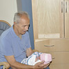 Grandpa Hintson  holding Grace for the first time.