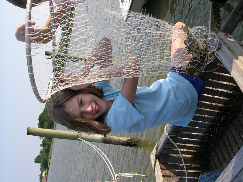 Grace caught some blue crabs on her granfathers dock.