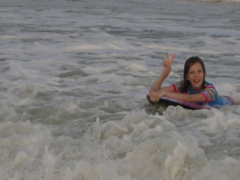 Grace rideing the waves in Bare Island South Carolina on 2006.