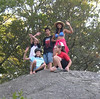 Grace and friends ontop of large glacial rock in Cape Cod 2006.