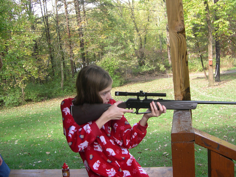 Grace shoots at a target in her PJ's in WV with a BB gun.