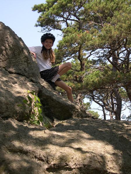 Grace climbing the great glacial rock in Cape Cod on the summer of 2005.
