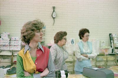 Cheryl Giacomazzi, Cody Hahn and Mary Lou Freeman at their shop in the Ridgewood Shopping Center, Garland, Texas, July 1974