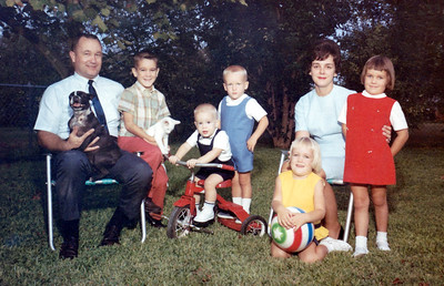 Fall 1967 Family Photo taken by Bob DeBolt Photography in Conder Park (just below the office). Our dog, Susie, and cat, M.C.?, were with us. Grady and Mary Clare, John, Kathy, Betsy, Patrick and Andrew Kane. This was for our 1967 Christmas Card.