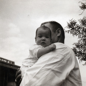 Kathy, 2 months, with her father, Grady Kane, in front of Grady's veterinary clinic at 1911 East Hwy 190, Killeen, Texas. July 1962.