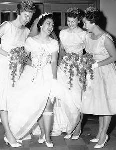 Mary Clare Galligan with her bridesmaids, Marlene Allard, Mary Clare Davidson, and Cathy Krause, Holy Spirit Catholic Church, St. Paul, MN, July 16, 1960.