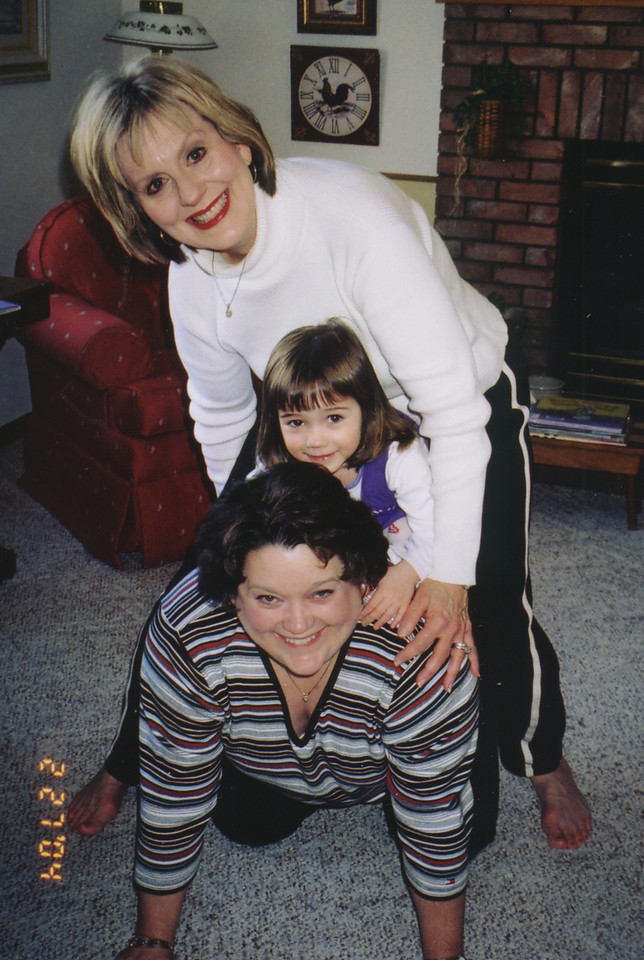 Cheryl Giacomazzi and Kathy Kane playiing with Rachel Kane at Grandma's house, Feb, 2004.