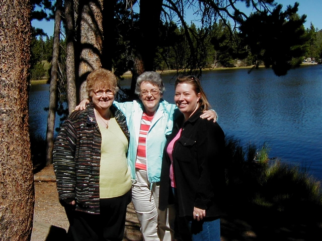 September and a beautiful day in Rocky Mountain National Park.  Myra Kane, Mary Clare Kane, and Lisa Miller pose next to Sprague Lake.