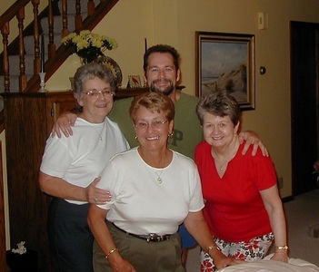 September, 2004, and the big 50th for Mary Clare Kane, Marlene Allard, and Sue Cardinal.  Our gracious host, Steve Cardinal, tries to hold them down...