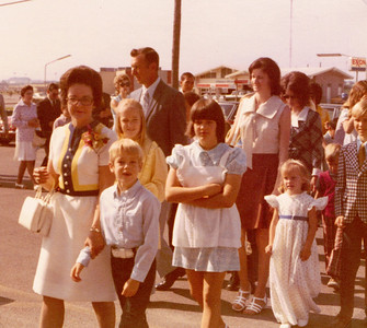 Mary Clare Kane with Andrew heading into St. Joseph's Church in Killeen, Texas, for his First Communion. Betsy and Kathy are behind them. May 12, 1974.