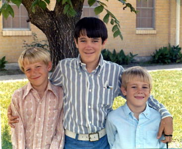 Andrew Kane (right, age 8 next month), with brothers Patrick (age 9.5) and John (age 13 in two weeks), on the day of his First Communion at St. Joseph's Catholic Church, Killeen, Texas. May 12, 1974.