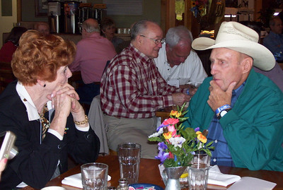 April 11-19, 2007; trip to Bandera, Texas, for Class of 1951 High School Reunion at Flyin L Guest Ranch.  About 60 classmates, spouses, and friends were in attendance.  Gwen (McCarty) Gray talking to Bob Kemp.  Grady Kane and Bob Webb are in the background.
