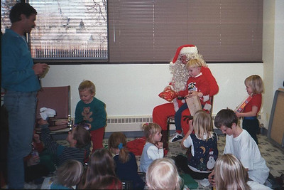 """Grady """"Santa Claus"""" Kane at the Center for Epidemiology and Animal Health (CEAH) Christmas party, Fort Collins, Colorado, 1996"""