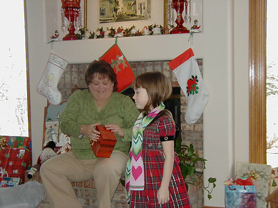 Opening of Christmas gifts at Grady and Mary Clare Kane's home.  Those present:  Andrew, Norma, Stephanie, Donald, and Chris Kane; John, Tracy and Rachel Kane and Dean Lanuke; Kathy Kane; Grady and Mary Clare Kane.