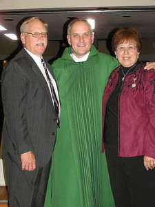 After Mike's ordination as a Transitional Deacon we came back to Fort Collins for Mike to give the homily at the 5 PM Mass at SEAS, followed by a reception in his honor.  Mike with his cousin, Stan, and sister, Jane.